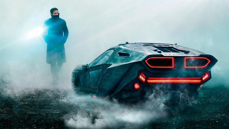 Ryan Gosling next to his brand new ride in Blade Runner 2049.