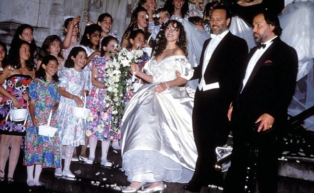 Mariah Carey and Tommy Mottola at their $500 000 wedding ceremony in 2003